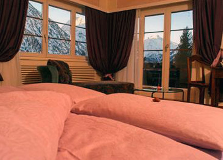Room with mountain views in Waldhotel Fletschhorn at Saas Fee.