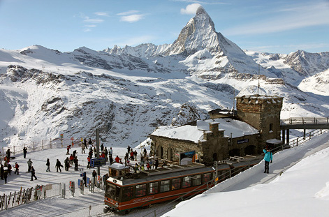 Train in Zermatt with Matterhorn in distance.